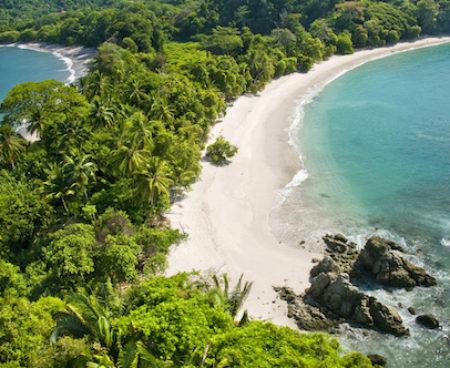 https://lostbeachtours.com/wp-content/uploads/2015/07/Costa-Rica-Aerial-view-of-Manuel-Antonio-jaco-450x368.jpg